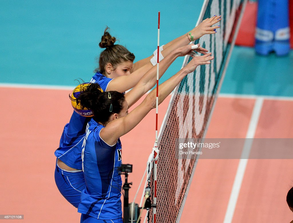 <a gi-track='captionPersonalityLinkClicked' href=/galleries/search?phrase=Nadia+Centoni&family=editorial&specificpeople=2309657 ng-click='$event.stopPropagation()'>Nadia Centoni</a> and Cristina Chirichella of Italy in action during the FIVB Women's World Championship 3rd Place Playoff match between Italy and Brazil on October 12, 2014 in Milan, Italy.