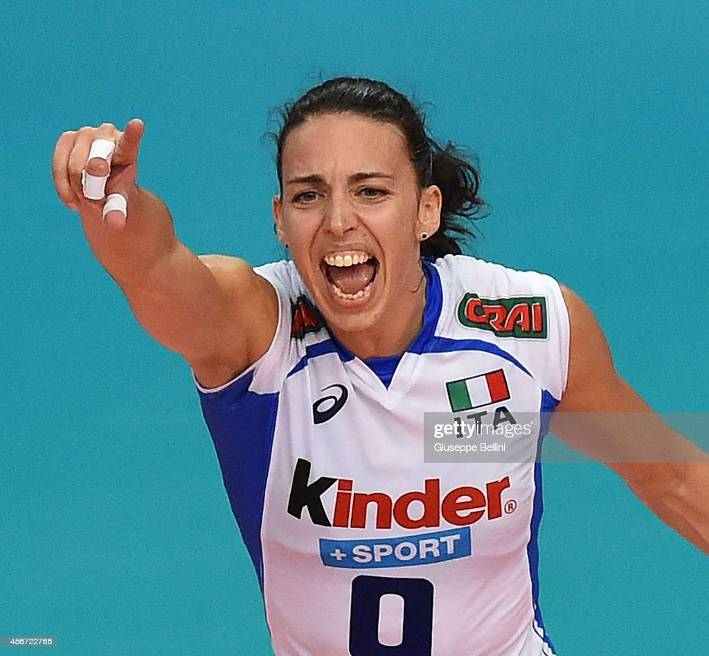 <a gi-track='captionPersonalityLinkClicked' href=/galleries/search?phrase=Nadia+Centoni&family=editorial&specificpeople=2309657 ng-click='$event.stopPropagation()'>Nadia Centoni</a> of Italy celebrates during the FIVB Women's World Championship pool E match between Italy and Belgium on October 2, 2014 in Bari, Italy.