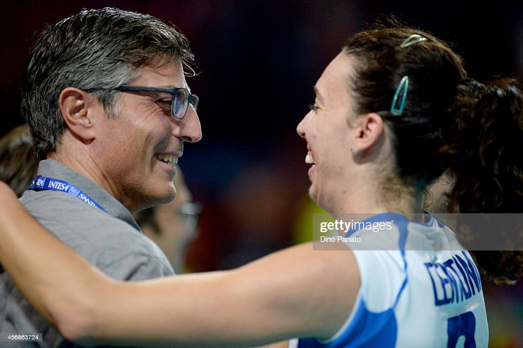 <a gi-track='captionPersonalityLinkClicked' href=/galleries/search?phrase=Nadia+Centoni&family=editorial&specificpeople=2309657 ng-click='$event.stopPropagation()'>Nadia Centoni</a> (R) of Italy celebrates victory after the FIVB Women's World Championship pool G match between Italy and USA on October 8, 2014 in Milan, Italy.