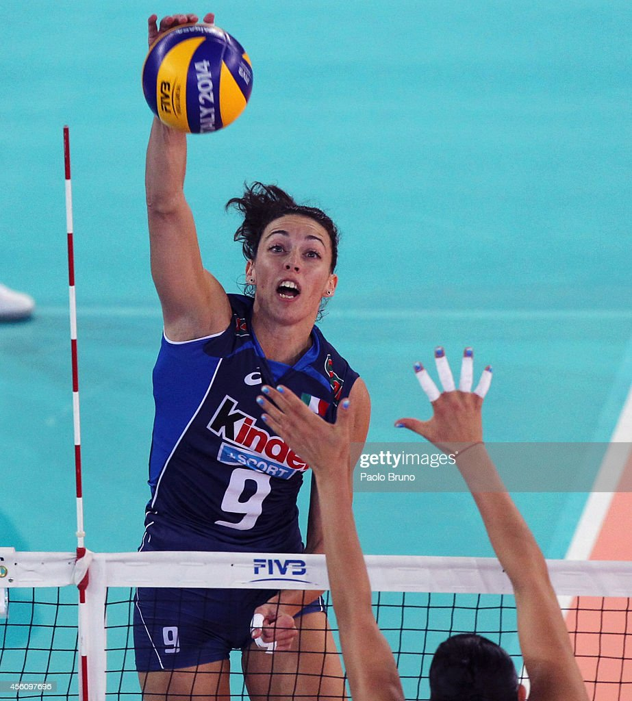 <a gi-track='captionPersonalityLinkClicked' href=/galleries/search?phrase=Nadia+Centoni&family=editorial&specificpeople=2309657 ng-click='$event.stopPropagation()'>Nadia Centoni</a> of Italy spikes the ball during the FIVB Women's World Championship pool A match between Argentina and Italy on September 25, 2014 in Rome, Italy.