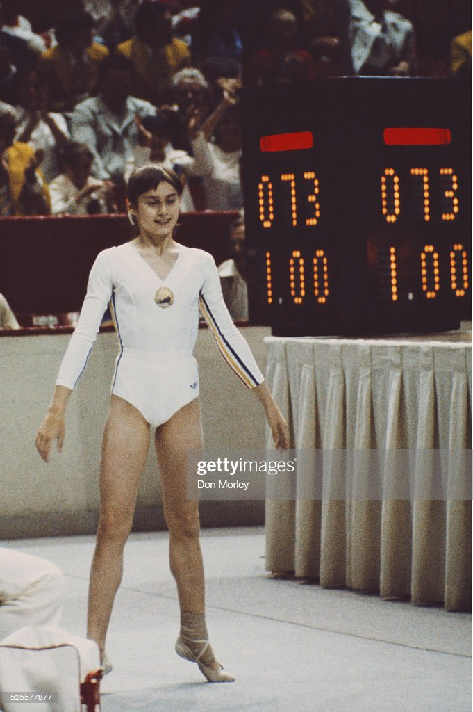 Nadia Comaneci of Romania is awarded a perfect ten after her routine on the uneven bars during the Women's artistic team allaround event on 18 July...