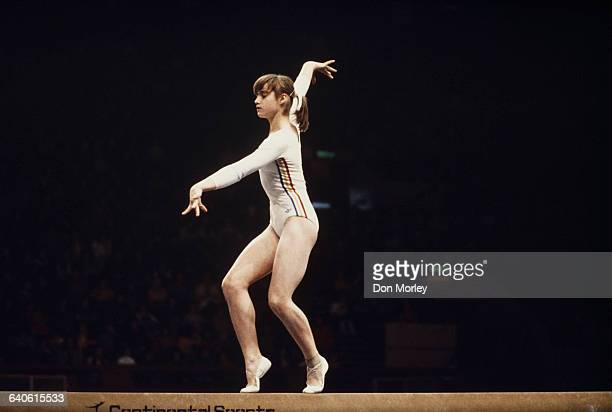 Nadia Comaneci of Romania performs her routine on the Balance Beam during the Women's ArtisticTeam allaround event on 19 July 1976 during the XXI...