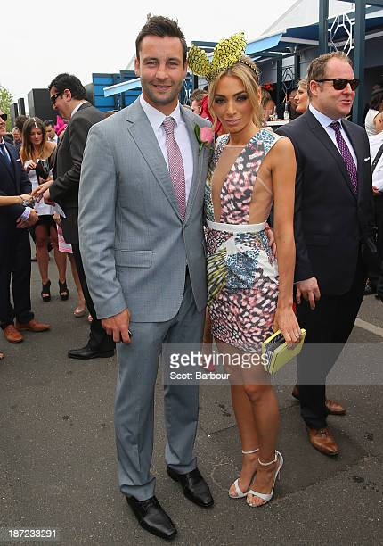 Nadia Coppolino and Jimmy Bartel attend during Oaks Day at Flemington Racecourse on November 7 2013 in Melbourne Australia