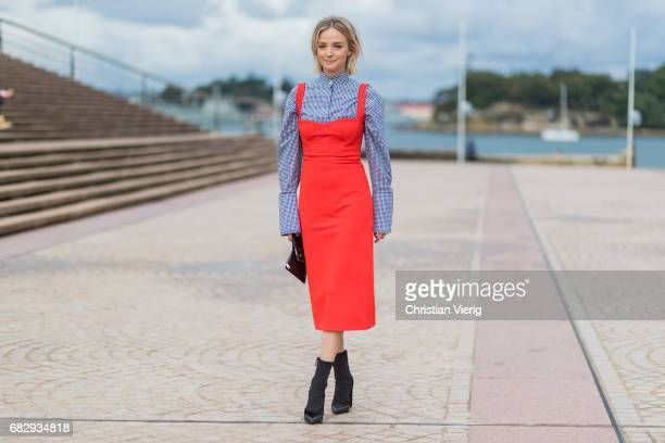 Nadia Fairfax wearing a checked button shirt Dion Lee and red dress Dion Lee during MercedesBenz Fashion Week Resort 18 Collections at Sydney Opera...
