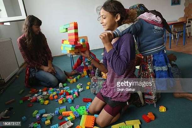Nadia Gavrila of the Romanian NGO OvidiuRo leads Roma children in play in the preschool class in the abjectly poor Roma settlement of Ponorata on...