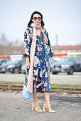 Nadia Missbach poses wearing an Aya coat and dress Loewe bag and Prada shoes before the Gucci show during the Milan Fashion Week Fall/Winter 2016/17...