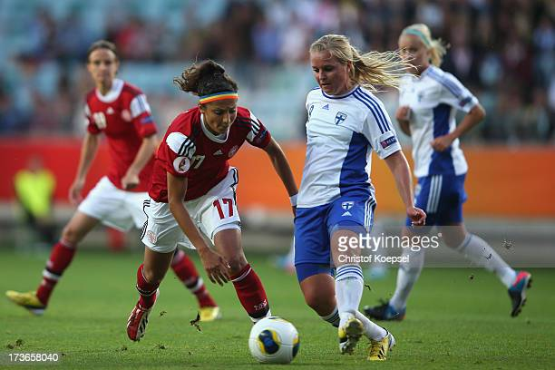Nadia Nadim of Denmark challenges Katri NoksoKoivisto of Finland during the UEFA Women's EURO 2013 Group A match between Denmark and Finland at Gamla...