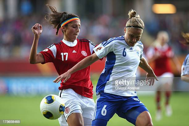 Nadia Nadim of Denmark challenges Laura Kivistoe of Finland during the UEFA Women's EURO 2013 Group A match between Denmark and Finland at Gamla...