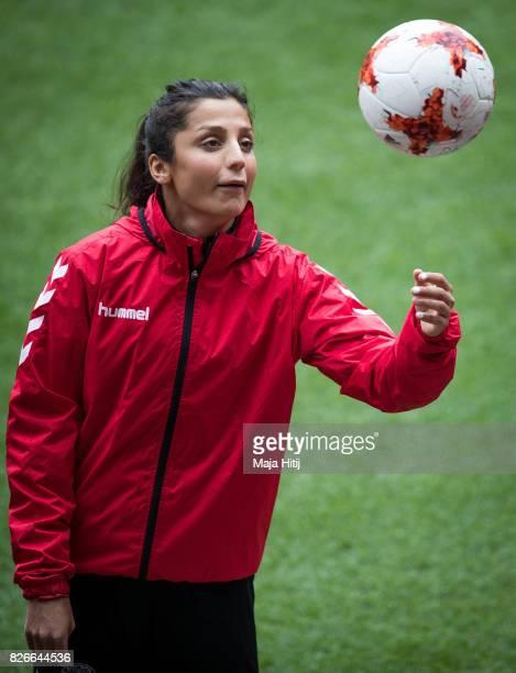 Nadia Nadim of Denmark holds the ball during a training prior UEFA Women's Euro 2017 Final against Netherlands at De Grolsch Veste Stadium on August...