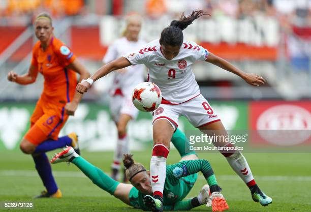 Nadia Nadim of Denmark is tackled by Sari van Veenendaal of the Netherlands during the Final of the UEFA Women's Euro 2017 between Netherlands v...