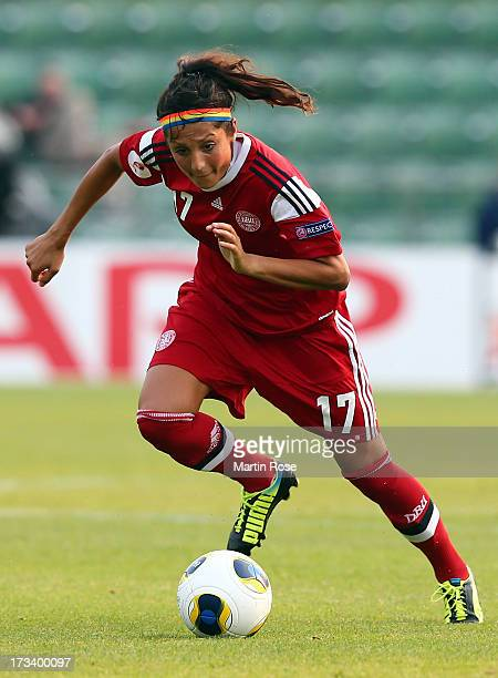 Nadia Nadim of Denmark runs with the ball during the UEFA Women's Euro 2013 group A match between Italy and Denmark at Orjans Vall on July 13 2013 in...
