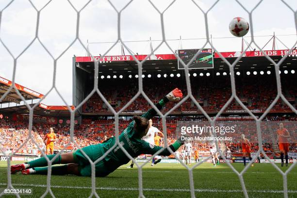 Nadia Nadim of Denmark scores the first goal of the game from the penalty spot past goalkeeper Sari van Veenendaal of the Netherlands during the...