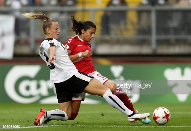 Nadia Nadim of Denmark shoots goalwards under pressure from Virginia Kirchberger of Austria during the UEFA Women's Euro 2017 Semi Final match...