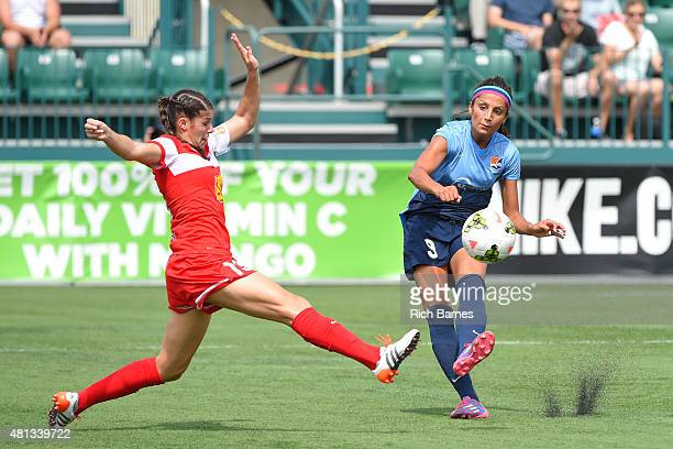 Nadia Nadim of Sky Blue FC takes a shot around Brittany Taylor of Western New York Flash during the first half at Sahlen's Stadium on July 19 2015 in...