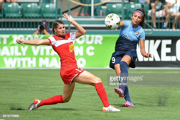Nadia Nadim of the Sky Blue FC shoots the ball against the defense of Brittany Taylor of the Western New York Flash during the first half at Sahlen's...