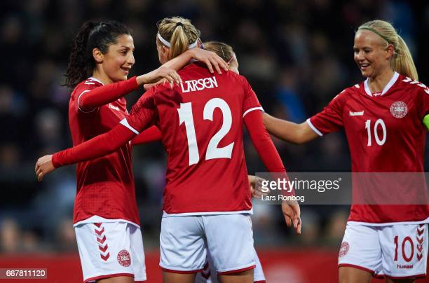 Nadia Nadim Stine Larsen and Pernille Harder of Denmark celebrate after scoring their third goal during the international friendly match between...
