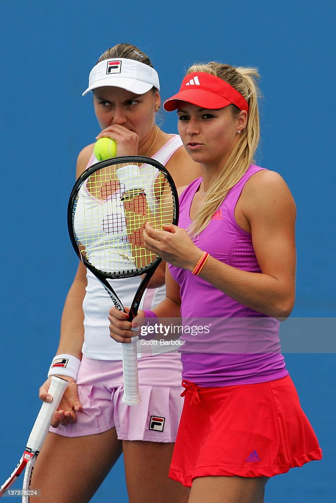 Nadia Petrova and Maria Kirilenko talk tactics in their second round doubles against Klaudia Jans-Ignacik and Urszula Redwanska of Poland during day five of the 2012 Australian Open at Melbourne Park on January 20, 2012 in Melbourne, Australia.