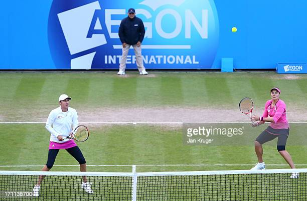 Nadia Petrova of Russia and partner Katarina Srebotnik of Slovenia in action during their women's doubles final match against Monica Niculescu of...