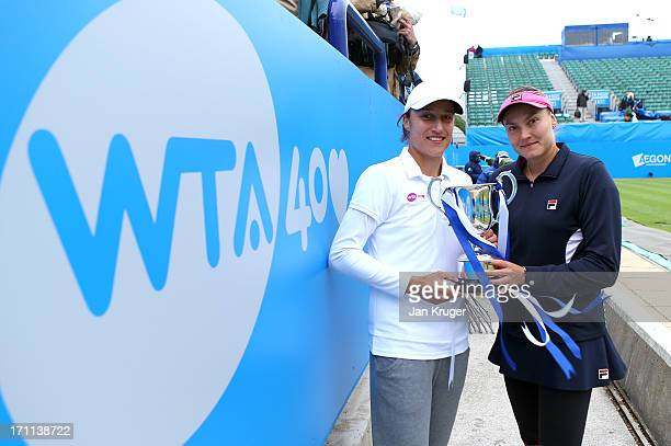 Nadia Petrova of Russia and partner Katarina Srebotnik of Slovenia pose with the trophy after winning the women's doubles final match against Monica...