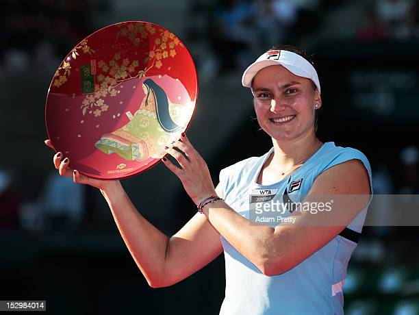 Nadia Petrova of Russia celebrates with the victory plate after victory over Agnieszka Radwanska of Poland in the womens final during day seven of...