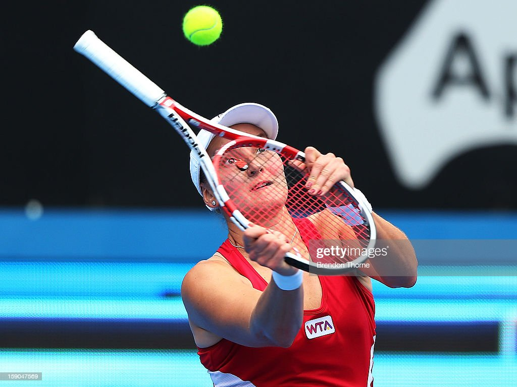 <a gi-track='captionPersonalityLinkClicked' href=/galleries/search?phrase=Nadia+Petrova&family=editorial&specificpeople=178321 ng-click='$event.stopPropagation()'>Nadia Petrova</a> of Russia plays an unorthodox shot in her first round match against Roberta Vinci of Italy during day two of the Sydney International at Sydney Olympic Park Tennis Centre on January 7, 2013 in Sydney, Australia.