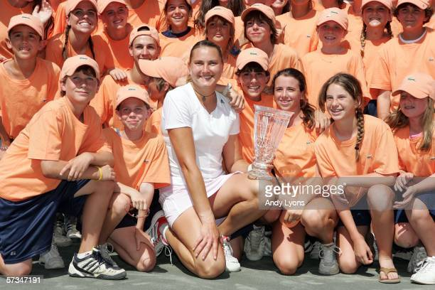 Nadia Petrova of Russia poses with the ball girls and ball boys after beating Patty Schnyder of Switzerland in the final of the Family Circle Cup on...