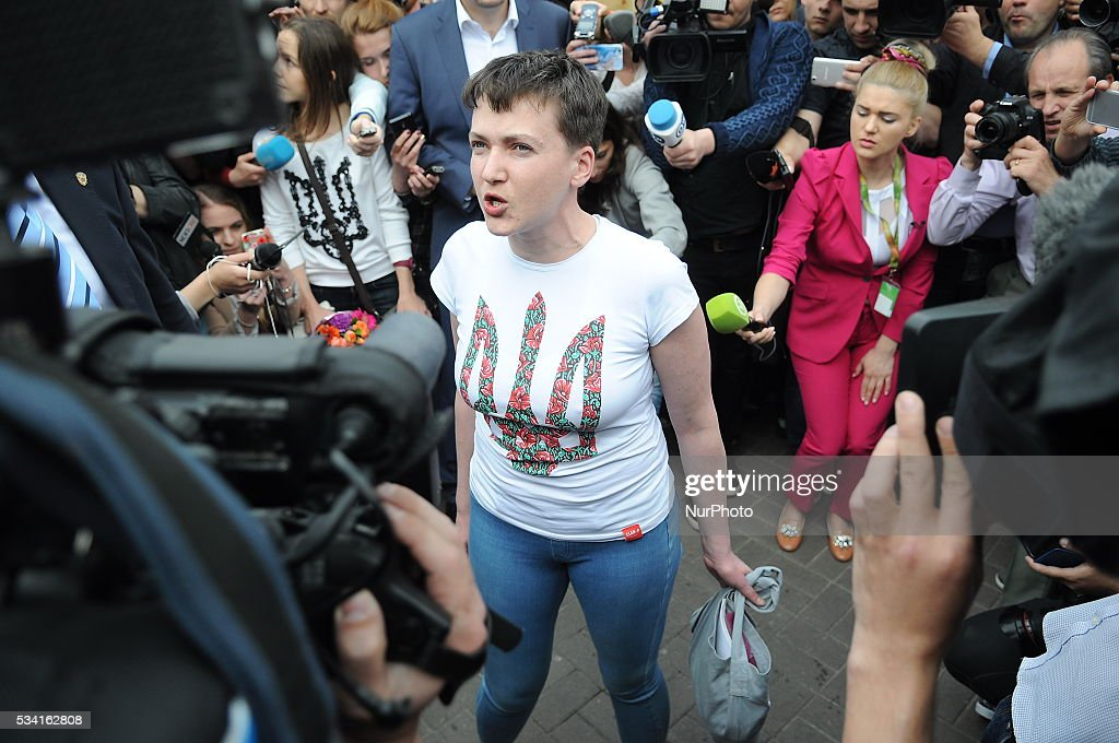 Nadia Savchenko (C), Ukrainian pilot, member of the Ukrainian parliament and member of the Ukrainian delegation to PACE, speaks with journalists after arriving at the Boryspil International airport near Kiev, Ukraine, 25 May 2016. Nadia Savchenko was exchanged for two officers of a Russian Special Forces unit Alexander Alexandrov and Yevgeniy Yerofeyev. A court in Russia sentenced Savchenko to 22 years in prison after she was found guilty of taking part in an attack which killed two Russian television journalists. A Ukrainian court has sentenced officers of a Russian Special Forces unit Alexander Alexandrov and Yevgeniy Yerofeyev, who were captured not far from pro-Russian rebel-controlled territory near the town of Schastye, Luhansk area, to 14 years in prison each, with the confiscation of property.