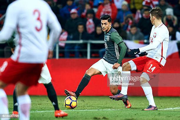 Nadiem Amiri from Germany fights for the ball with Dawid Kownacki from Poland during the International Friendly soccer match between Poland U21 and...
