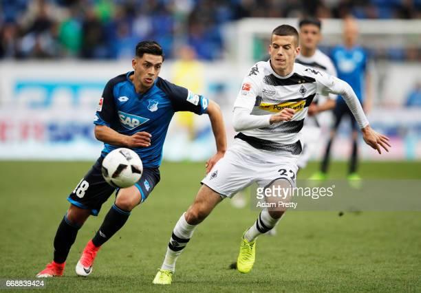 Nadiem Amiri of 1899 Hoffenheim is challenged by Laszlo Benes of Borussia Moenchengladbach during the Bundesliga match between TSG 1899 Hoffenheim...
