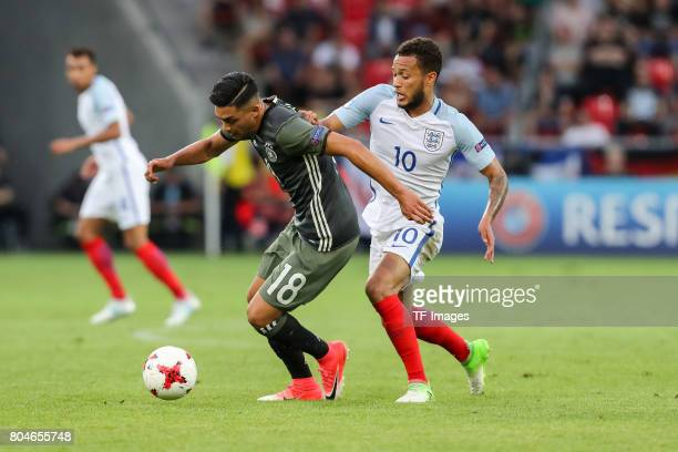 Nadiem Amiri of Germany and Lewis Baker of England battle for the ball during the UEFA European Under21 Championship Semi Final match between England...