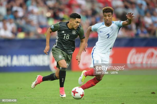 Nadiem Amiri of Germany attempts to take the ball past Mason Holgate of England during the UEFA European Under21 Championship Semi Final match...