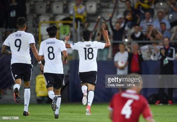 Nadiem Amiri of Germany celebrates after he scored his side's third goal during their UEFA Under21 Championship Group C match between Germany and...