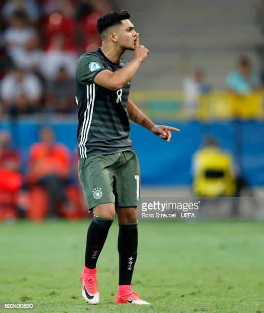 Nadiem Amiri of Germany celebrates after scoring during the penatly shoot out after the UEFA European Under21 Championship Semi Final match between...