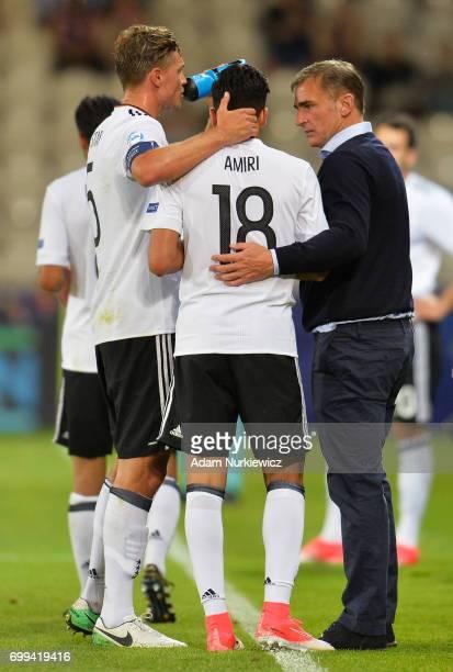 Nadiem Amiri of Germany celebrates scoring his sides third goal with Stefan Kuntz coach of Germany during the UEFA European Under21 Championship...