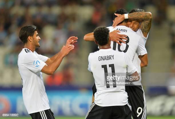 Nadiem Amiri of Germany celebrates scoring his sides thiwrd goal ith Davie Selke of Germany during the UEFA European Under21 Championship Group C...