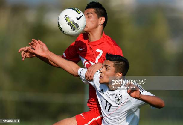Nadiem Amiri of Germany is challenged by Arif Demir of Turkey during the U18 international friendly match between Turkey and Germany on November 18...