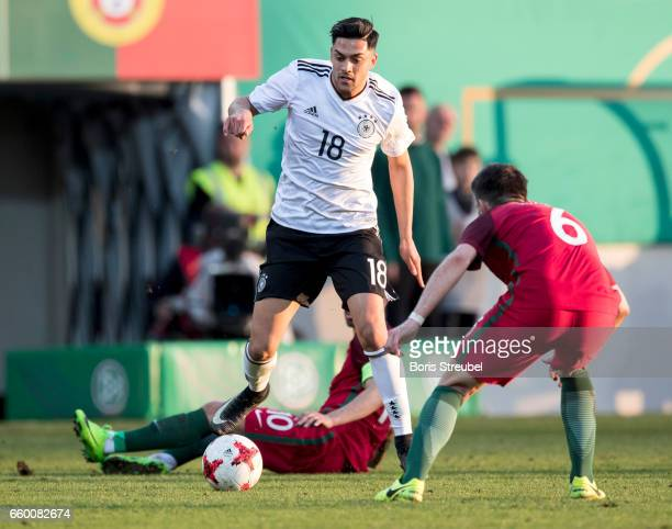 Nadiem Amiri of Germany is challenged by Bruno Fernandes of Portugal during the International Friendly match between Germany U21 and Portugal U21 at...