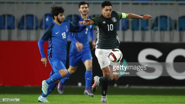Nadiem Amiri of Germany is challenged by Ilkin Muradov of Azerbaijan during the UEFA Under21 Euro 2019 Qualifier match between Azerbaijan U21 and...