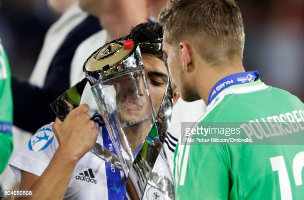 Nadiem Amiri of Germany kisses the trophy after the UEFA U21 Final match between Germany and Spain at Krakow Stadium on June 30 2017 in Krakow Poland