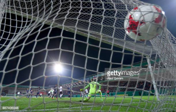 Nadiem Amiri of Germany scores his teams first goal against Jordan Pickford of England during the U21 international friendly match between Germany...