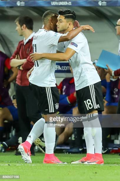 Nadiem Amiri of Germany shakes hands with Serge Gnabry of Germany during the UEFA U21 Final match between Germany and Spain at Krakow Stadium on June...