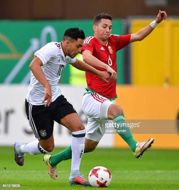 Nadiem Amiri of Germany U21 is challenged by Mate Vida of Hungary 21 during the International friendly match between Germany U21 and Hungary U21 at...