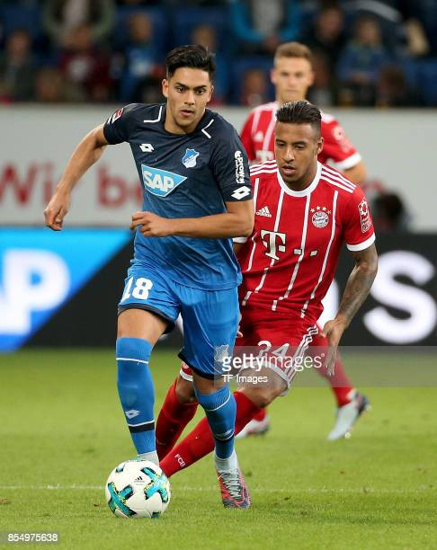 Nadiem Amiri of Hoffenheim and Corentin Tolisso of Muenchen battle for the ball during the Bundesliga match between TSG 1899 Hoffenheim and FC Bayern...