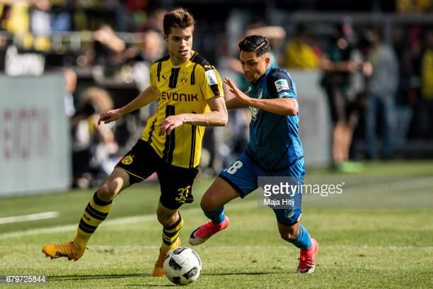 Nadiem Amiri of Hoffenheim and Julian Weigl of Dortmund battle for the ball during the Bundesliga match between Borussia Dortmund and TSG 1899...