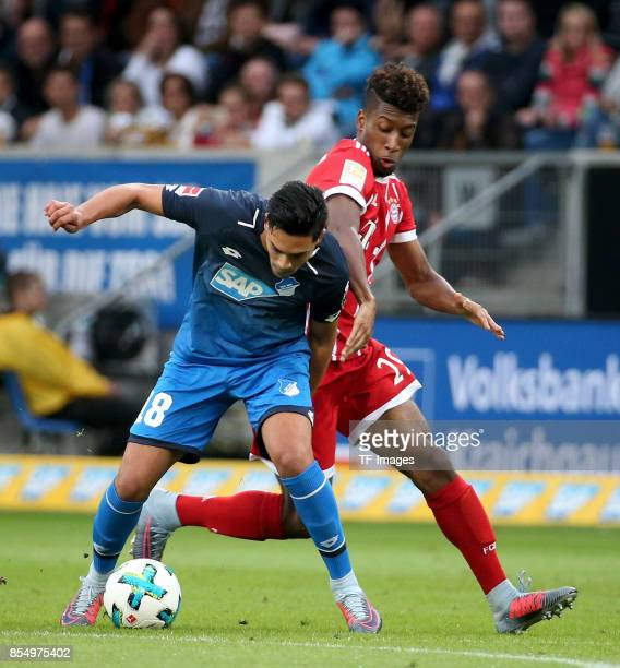 Nadiem Amiri of Hoffenheim and Kingsley Coman of Muenchen battle for the ball during the Bundesliga match between TSG 1899 Hoffenheim and FC Bayern...