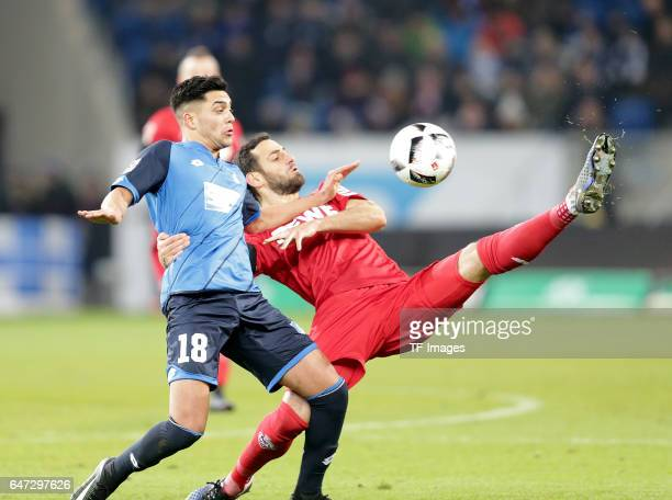 Nadiem Amiri of Hoffenheim and Mergim Mavraj of FC Koeln battle for the ball during the Bundesliga match between TSG 1899 Hoffenheim and 1 FC Koeln...