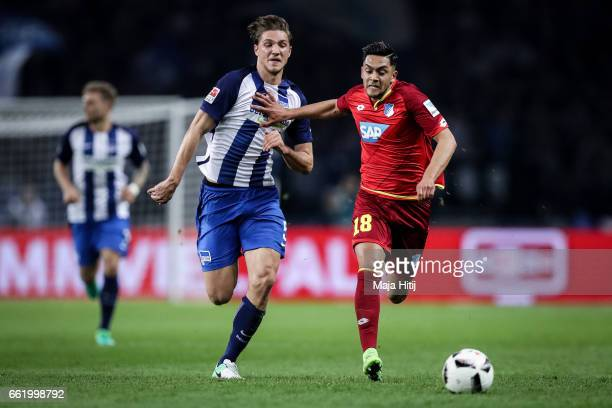 Nadiem Amiri of Hoffenheim and Niklas Stark of Berlin battle for the ball during the Bundesliga match between Hertha BSC and TSG 1899 Hoffenheim at...