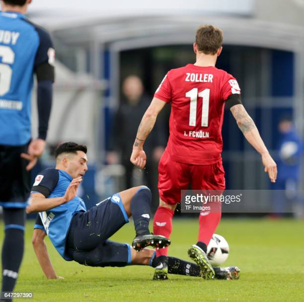 Nadiem Amiri of Hoffenheim and Simon Zoller of FC Koeln battle for the ball during the Bundesliga match between TSG 1899 Hoffenheim and 1 FC Koeln at...