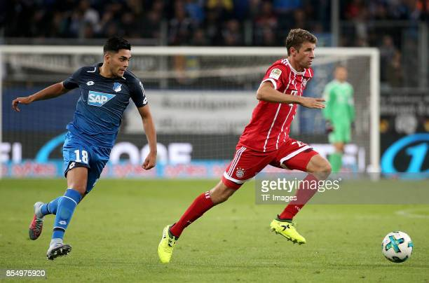 Nadiem Amiri of Hoffenheim and Thomas Müller of Muenchen battle for the ball during the Bundesliga match between TSG 1899 Hoffenheim and FC Bayern...
