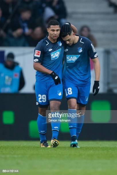 Nadiem Amiri of Hoffenheim celebrates his team's first goal withj team mate Serge Gnabry during the Bundesliga match between TSG 1899 Hoffenheim and...